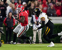 ATHENS, GA - NOVEMBER 09: D'Andre Swift #7 of the Georgia Bulldogs runs with the ball while Khalil Oliver #20 of the Missouri Tigers pursues him during a game between Missouri Tigers and Georgia Bulldogs at Sanford Stadium on November 09, 2019 in Athens, Georgia.