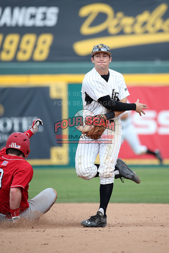 Jarren Duran (4) of the Long Beach State Dirtbags throws to first base to complete a double play during a game against the Nebraska Cornhuskers in the first game of a doubleheader at Blair Field on March 5, 2016 in Long Beach, California. Long Beach State defeated Nebraska, 1-0. (Larry Goren/Four Seam Images)