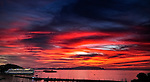 Red sunset with cruise ship docked in Kusadasi, Turkey
