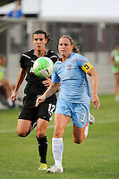 Christie Rampone (3) of Sky Blue FC and Christine Sinclair (12) of FC Gold Pride run onto a ball played into space. Sky Blue FC and FC Gold Pride played to a 1-1 tie during a Women's Professional Soccer (WPS) match at Yurcak Field in Piscataway, NJ, on September 01, 2010.
