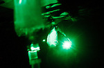 "IVs are seen under a green light as a US Medevac helicopter from the 101st Aviation Regiment flies on a rescue mission at night to collect 2 American soldiers, wounded in an Improvised Explosive Deviece (IED) attack, and take them Forward Operating Base Orgun-E in Paktika province, Afghanistan, 21 July, 2008. Also known by their call sign ""Dust Off"","" the Medevac pilots, crew and medics are ready to fly at a moments notice, picking up Coalition soldiers as well as Afghans that require help.(John D McHugh)"