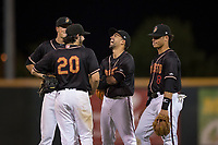 Modesto Nuts infielders joke around through a pitching change during a California League game against the Lake Elsinore Storm at John Thurman Field on May 11, 2018 in Modesto, California. Modesto defeated Lake Elsinore 3-1. (Zachary Lucy/Four Seam Images)