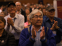 AFN attendees stand and applaud as Lt. Governor Byron Mallott takes the stage at the 2015 Alaska Federation of Natives Convention at the Dena'ina Center.