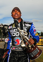 Sept. 5, 2011; Claremont, IN, USA: NHRA top fuel dragster driver Antron Brown celebrates after winning the US Nationals at Lucas Oil Raceway. Mandatory Credit: Mark J. Rebilas-