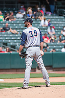 Jim Henderson (39) of the Colorado Springs Sky Sox looks to the plate for the sign delivers against the Salt Lake Bees in Pacific Coast League action at Smith's Ballpark on May 24, 2015 in Salt Lake City, Utah.  (Stephen Smith/Four Seam Images)