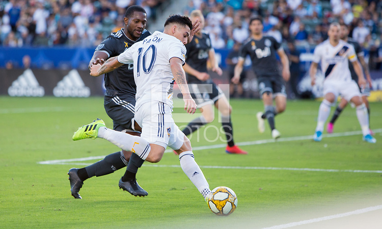 CARSON, CA - SEPTEMBER 29: Cristian Pavon #10 of the Los Angeles Galaxy crosses a ball during a game between Vancouver Whitecaps and Los Angeles Galaxy at Dignity Health Sports Park on September 29, 2019 in Carson, California.
