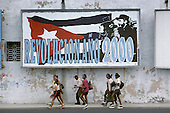 School children pass a street hoarding in Central Havana celebrating the anniversary of the 1959 revolution.