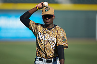 Eric Jenkins (12) of the Down East Wood Ducks warms up in the outfield prior to the game against the Winston-Salem Dash at BB&T Ballpark on May 12, 2018 in Winston-Salem, North Carolina. The Wood Ducks defeated the Dash 7-5. (Brian Westerholt/Four Seam Images)