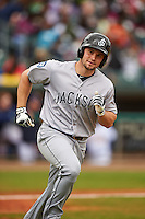 Jackson Generals outfielder Dario Pizzano (9) runs to first on a base hit during a game against the Montgomery Biscuits on April 29, 2015 at Riverwalk Stadium in Montgomery, Alabama.  Jackson defeated Montgomery 4-3.  (Mike Janes/Four Seam Images)