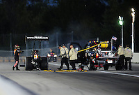 Sept. 3, 2010; Clermont, IN, USA; NHRA top fuel dragster driver Cory McClenathan (left) signals a fire to the safety safari crew during qualifying for the U.S. Nationals at O'Reilly Raceway Park at Indianapolis. Mandatory Credit: Mark J. Rebilas-