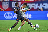 5th September 2021; Nashville, TN, USA;  Canada defender Richie Laryea challenges United States defender Antonee Robinson (5) during a CONCACAF World Cup qualifying match between the United States and Canada on September 5, 2021 at Nissan Stadium in Nashville, TN.