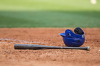 A Tennessee Smokies batting helmet and bat lay near home plate during the game against the Birmingham Barons at Regions Field on May 3, 2015 in Birmingham, Alabama.  The Smokies defeated the Barons 3-0.  (Brian Westerholt/Four Seam Images)