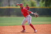 Philadelphia Phillies shortstop Jonathan Guzman (8) looks to throw to third base after catching a line drive during an exhibition game against the Canada Junior National Team on March 11, 2020 at Baseball City in St. Petersburg, Florida.  (Mike Janes/Four Seam Images)