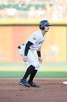 Adam Engel (7) of the Charlotte Knights takes his lead off of second base against the Durham Bulls at BB&T BallPark on May 15, 2017 in Charlotte, North Carolina. The Knights defeated the Bulls 6-4.  (Brian Westerholt/Four Seam Images)