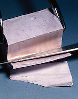 SODIUM METAL CUT WITH KNIFE<br /> Has Silvery Appearance When Freshly Cut. However, sodium quickly tarnishes as it is exposed to air.