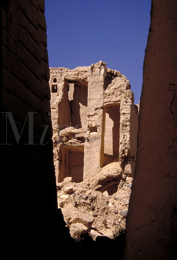 Old mud brick ruins spotted through a crevice. Ma'rib, Yemen.