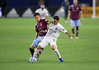 CARSON, CA - SEPTEMBER 19: Cristian Pavon #10 of the Los Angeles Galaxy battles with Cole Bassett #26 of the Colorado Rapids for a ball during a game between Colorado Rapids and Los Angeles Galaxy at Dignity Heath Sports Park on September 19, 2020 in Carson, California.