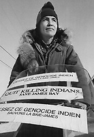 An Indian at Fort George on James Bay uses the windshield of his snowmobile as a travelling billboard. The Indians' hunting grounds in the area are threatened with flooding by the Quebec government's hydro project and Anglican and Roman Catholic clergy are protesting.<br /> <br /> 1974<br /> <br /> PHOTO :  Bob Olsen - Toronto Star Archives - AQP