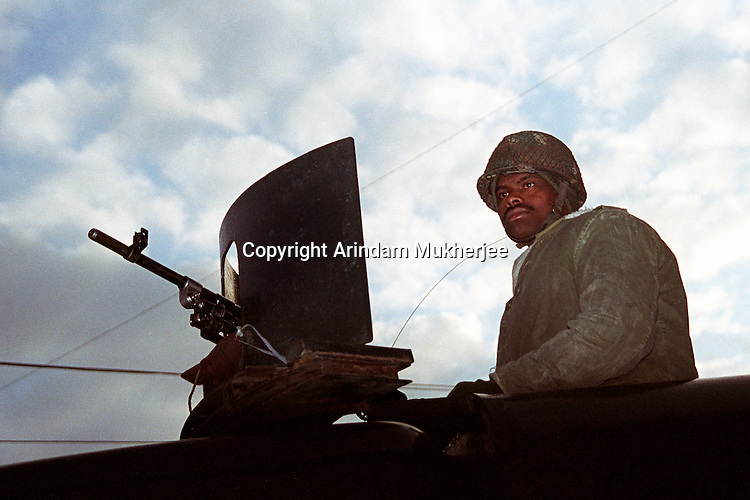 An Indian army personnel stand guard on a vehicle with a Light Machine Gun at Srinagar. kashmir valley, India.