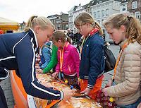 April 17, 2015, Netherlands, Den Bosch, Maaspoort, Fedcup Netherlands-Australia,  Kiki Bertens (NED) signing  aurographs<br /> Photo: Tennisimages/Henk Koster