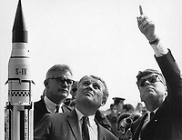 Kennedy Space Center (FLA) USA  -  11/16/1963 File Photo - Dr. Wernher von Braun explains the Saturn Launch System to President John F. Kennedy. NASA Deputy Administrator Robert Seamans is to the left of von Braun.