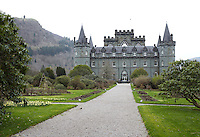 The brooding garden facade of Inverary Castle with rows of neo-gothic windows overlooking the park