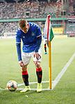 22.08.2019 Legia Warsaw v Rangers: Steven Davis removes lighters thrown at him as he prepares to take a corner