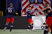 20th November 2020; Foxborough, MA, USA;  New England Revolution forward Carles Gil celebrates his goal as New England Revolution midfielder Teal Bunbury rushes in during the MLS Cup Play-In game between the New England Revolution and the Montreal Impact