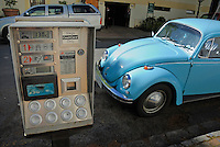 Blue Beetle car by a parking meter on the street, Stellenbosch, Western Cape Province, South Africa