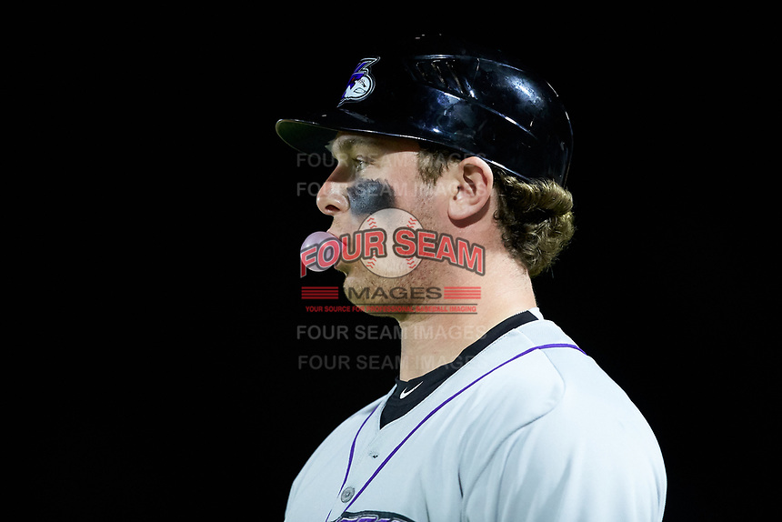 Winston-Salem Dash pitcher John Parke (28) blows a bubble while he coaches first base during the game against the Myrtle Beach Pelicans at TicketReturn.com Field on May 16, 2019 in Myrtle Beach, South Carolina. The Dash defeated the Pelicans 6-0. (Brian Westerholt/Four Seam Images)