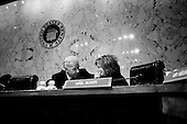 Washington DC, .District of Columbia.USA.January 31, 2007..At a Senate hearing with Henry Kissinger concerning the war in Iraq, US Senator Barbara Boxer from California and Joe Biden from Delaware discuss privately....