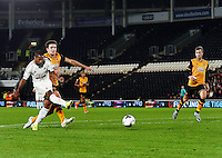 Wayne Routledge of Swansea City has a shot at goal during the Capital One Cup match between Hull City and Swansea City played at the Kingston Communications Stadium, Hull