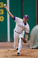 LSU Tigers pitcher Kevin Gausman #12 throws in the bullpen before the continuation of their suspended NCAA Super Regional baseball game against Stony Brook on June 9, 2012 at Alex Box Stadium in Baton Rouge, Louisiana. LSU defeated Stony Brook 5-4 in 12 innings. (Andrew Woolley/Four Seam Images)