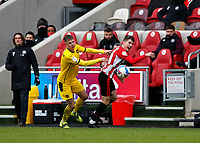 14th February 2021; Brentford Community Stadium, London, England; English Football League Championship Football, Brentford FC versus Barnsley; Mads Juel Andersen of Barnsley challenges Sergi Canos of Brentford