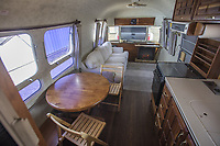BNPS.co.uk (01202 558833)<br /> Pic: PawelLitwinski/Bonhams/BNPS<br /> <br /> PICTURED: The airstream trailer superstar Tom Hanks used on film sets for over 30 years has sold for £170,000.<br /> <br /> The award-winning actor bought and personally equipped the trailer in 1993 and made it his 'home away from home' on 18 different movie sets across America.<br /> <br /> The Hollywood star decided to put his 1992 Airstream up for auction at Bonhams in LA, along with the Ford pickup he used to tow it, his high-performance Tesla Model S and a 1980 Toyota Land Cruiser.<br /> <br /> In total the vehicles sold for £368,577.