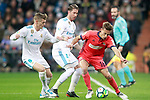 Real Madrid's Toni Kroos (l) and Sergio Ramos (c) and Real Sociedad's Sergio Canales during La Liga match. February 10,2017. (ALTERPHOTOS/Acero)