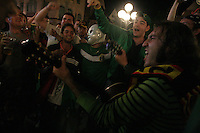 Mexican soccer fans sing and dance along to a Mexican folk band who played Mexican folk  music late into the night on the streets of the old town  of Nuremburg, Germany.  The fans were in town to watch the FIFA World Cup second round match of Portugal against Netherlands at the Nuremburg World Cup stadium on Sunday, June 25nd, 2006.
