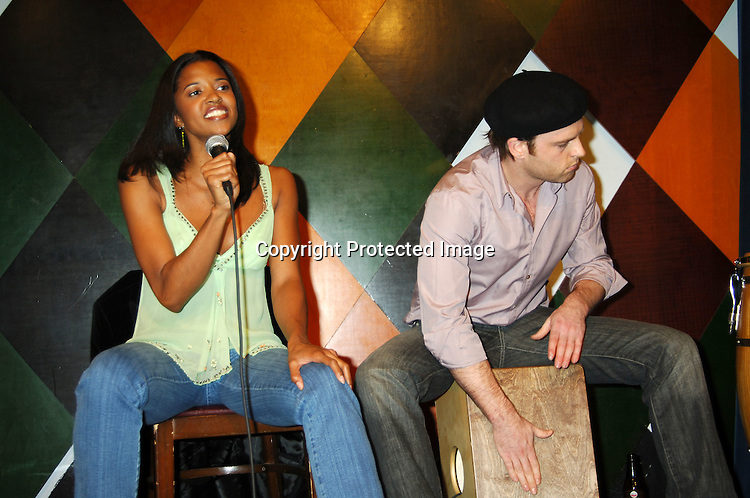 Renee Elise Goldsberry singing and Trevor St John playing the Cajon ..at The Launch of the One Life, Many Voices CD, ..which is a 26 Track compilation CD,comprised of original ..material, covers and spoken word. It was produced and sung by actors who star on One Life To Live and will  benefit Hurricane Relief. The event was on January 11, 2006 at Caroline's Comedy Club...Photo by Robin Platzer, Twin Images