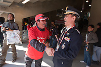 A South Korea fan and police officer share a laugh  at Soccer City in Johannesburg, South Africa on Thursday, June 17, 2010 during Argentina's and South Korea FIFA World Cup first round match.