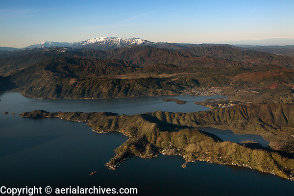 aerial photograph of Clearlake Park penninsula and Borax Lake in the foreground.  Clear Lake Keys and Clearlake Oaks are in the middle ground. The snow covered mountains of the Mendocino National Forest are in the background.