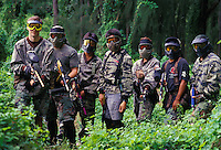 Line up of men and women who engage in paintball sport, a paramilitary leisure type game
