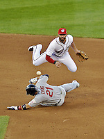11 October 2012: Washington Nationals second baseman Danny Espinosa attempts a double-play during Postseason Playoff Game 4 of the National League Divisional Series against the St. Louis Cardinals at Nationals Park in Washington, DC. The Nationals defeated the Cardinals 2-1 on a 9th inning, walk-off solo home run by Jayson Werth, tying the Series at 2 games apiece. Mandatory Credit: Ed Wolfstein Photo