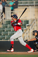 Jose Pujols (23) of the Lakewood BlueClaws follows through on his swing against the Kannapolis Intimidators at Kannapolis Intimidators Stadium on May 10, 2016 in Kannapolis, North Carolina.  The BlueClaws defeated the Intimidators 5-3.  (Brian Westerholt/Four Seam Images)