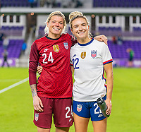 ORLANDO, FL - JANUARY 22: Jane Campbell #24 and Kristie Mewis #22 of the USWNT pose for a photo after a game between Colombia and USWNT at Exploria stadium on January 22, 2021 in Orlando, Florida.
