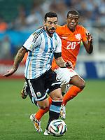 Ezequiel Lavezzi of Argentina and Georginio Wijnaldum of the Netherlands