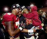 Seminole offensive lineman Cameron Erving, quarterback Jameis Winston carrying his little brother Jonah leave the field at the BCS national title game at the Rose Bowl in Pasadena, California on January 6, 2014.  Florida State Seminoles defeated the Auburn Tigers 34-31.