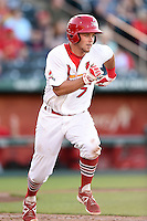 Springfield Cardinals second baseman Jacob Wilson (7) runs to first during a game against the Frisco Rough Riders on June 1, 2014 at Hammons Field in Springfield, Missouri.  Springfield defeated Frisco 3-2.  (Mike Janes/Four Seam Images)