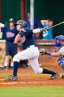 Bo Altobelli #4 of the Elizabethton Twins follows through on his swing against the Bluefield Blue Jays at Joe O'Brien Field on July 14, 2012 in Elizabethton, Tennessee.  The Twins defeated the Blue Jays 4-0.  (Brian Westerholt/Four Seam Images)
