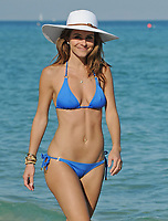 MIAMI BEACH, FL - DECEMBER 30:  The sexy 33-year-old television presenterMaria Menounos, looking sexy in a blue bikini with boyfriend Kevin Undergaro in Miami Beach.  Maria Menounos (born June 8, 1978) is an American actress, journalist, and television presenter known in America for her appearances as a correspondent for Today, Access Hollywood, Extra, and abroad for co-hosting the Eurovision Song Contest 2006 in Athens, Greece.  On December 30, 2011 in Miami Beach, Florida<br /> <br /> <br /> People:  Maria Menounos
