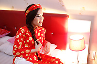 Model released adult vietnamese girl posing in traditional bouddhist wedding dress
